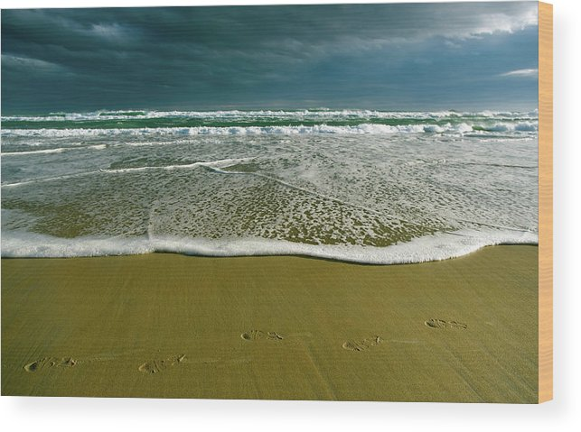 Water's Edge Wood Print featuring the photograph Footsteps And Storm Light by Jill Ferry