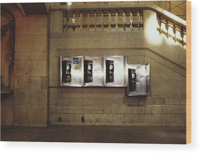 Pay Phone Wood Print featuring the photograph Four Telephone Booths On Marble Wall by Herb Schmitz