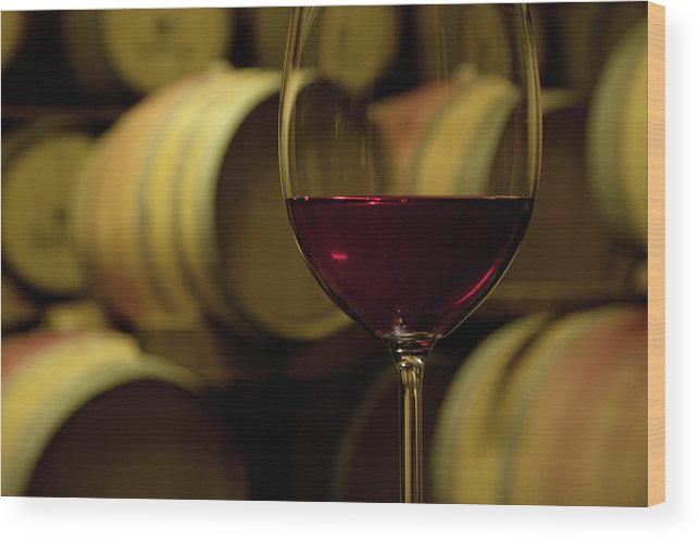 Stellenbosch Wood Print featuring the photograph Glass Of Red Wine In Wine Cellar by Siegfried Layda