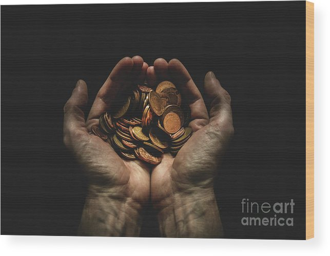 Coin Wood Print featuring the photograph Hands Holding Coins Against Black by Andy Kirby