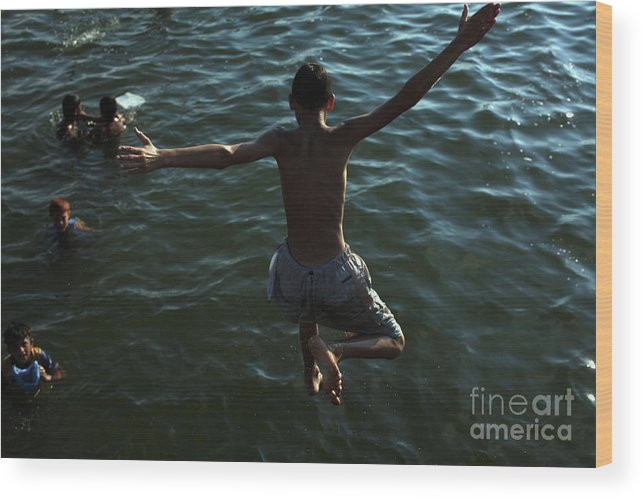Wind Wood Print featuring the photograph Israel Launches Airstrikes On Gaza by Christopher Furlong