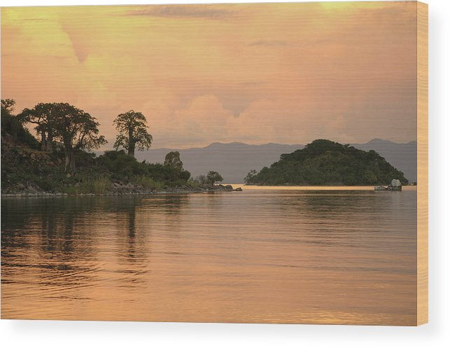 Orange Color Wood Print featuring the photograph Lake Malawi Sunset by Christophe cerisier