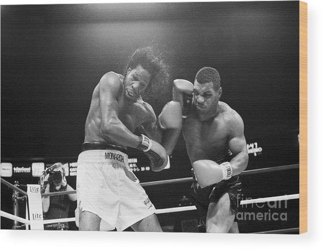 1980-1989 Wood Print featuring the photograph Mike Tyson Punches Mitch Green by Bettmann