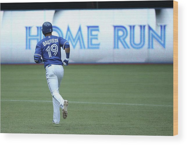 American League Baseball Wood Print featuring the photograph Milwaukee Brewers V Toronto Blue Jays by Tom Szczerbowski