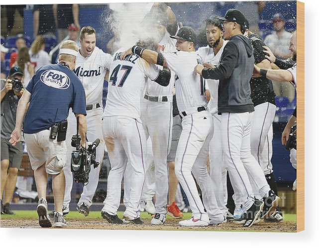 American League Baseball Wood Print featuring the photograph Minnesota Twins V Miami Marlins by Michael Reaves