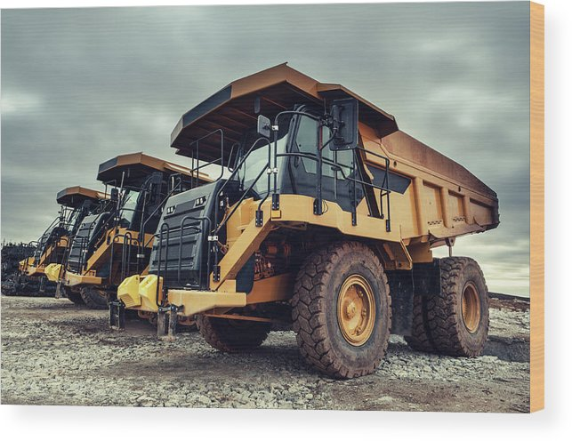 Construction Machinery Wood Print featuring the photograph Off-highway Dump Trucks by Shaunl