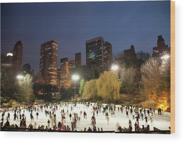 People Wood Print featuring the photograph Panorama Of People Ice Skating In by Studiokiet