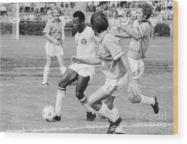 Pelé Wood Print featuring the photograph Pele Running With Soccer Ball by Bettmann