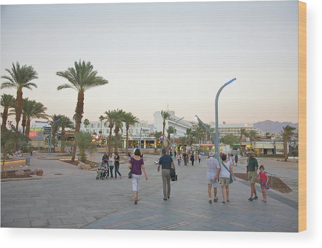 Child Wood Print featuring the photograph People Walking On Stone Plaza Near Palm by Barry Winiker