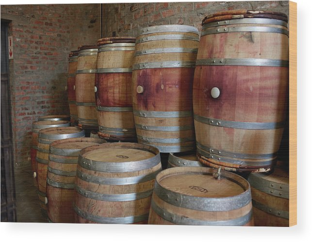 Stellenbosch Wood Print featuring the photograph Pile Of Wooden Barrels At Winery by Klaus Vedfelt