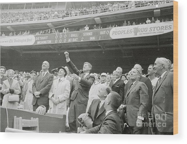 Crowd Of People Wood Print featuring the photograph President Kennedy Tossing Out First by Bettmann