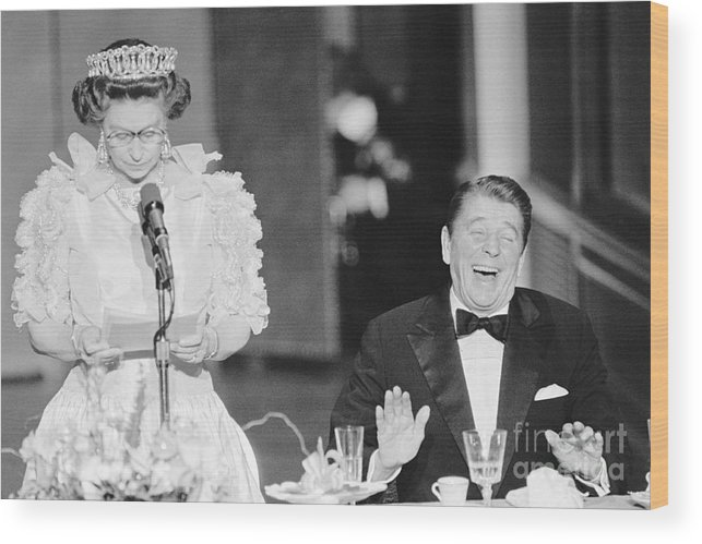 Following Wood Print featuring the photograph President Reagan Laughing At Queens by Bettmann
