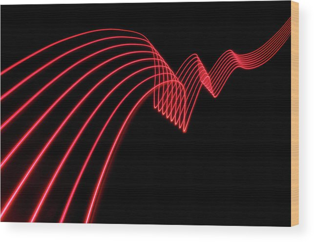 Laser Wood Print featuring the photograph Red Abstract Coloured Lights Trails And by John Rensten