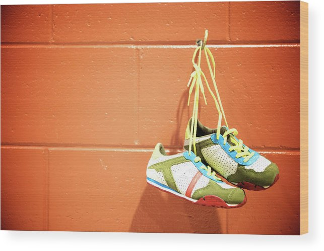 Hanging Wood Print featuring the photograph Runnig Shoes Hanging On A Hook by Pascalgenest