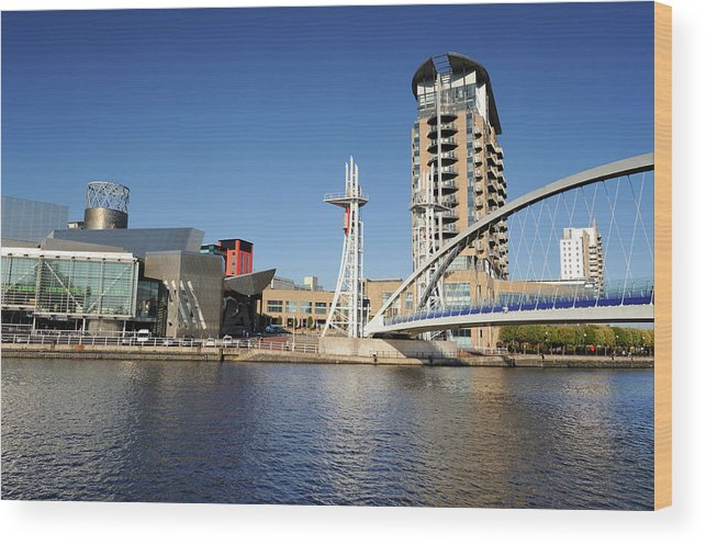 London Millennium Footbridge Wood Print featuring the photograph Salford Quays, Manchester by Chrishepburn