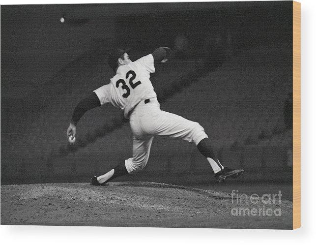 Sandy Koufax Wood Print featuring the photograph Sandy Koufax Pitching A No Hitter by Bettmann