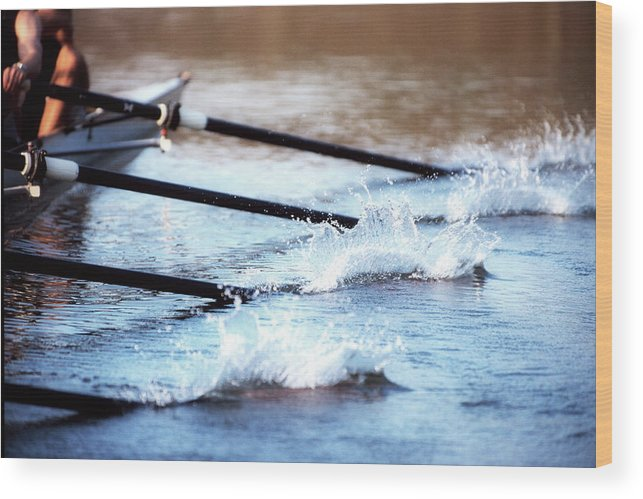 Sport Rowing Wood Print featuring the photograph Sculling Team Rowing On Water by Robert Llewellyn