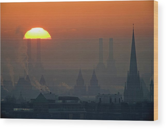 Tranquility Wood Print featuring the photograph Silhouettes Of Chimneys And Spires by James Burns