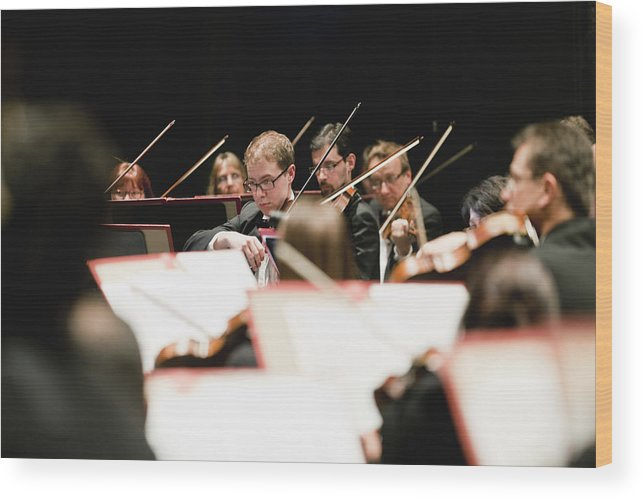 Young Men Wood Print featuring the photograph String Section In Orchestra by Hybrid Images
