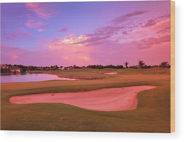 Sand Trap Wood Print featuring the photograph Sunrise View Of A Resort On A Golf by Rhz