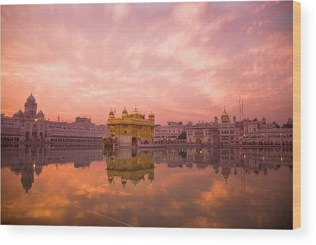 Golden Temple Wood Print featuring the photograph Sunset Over Sikhisms Holliest by Christopher Pillitz