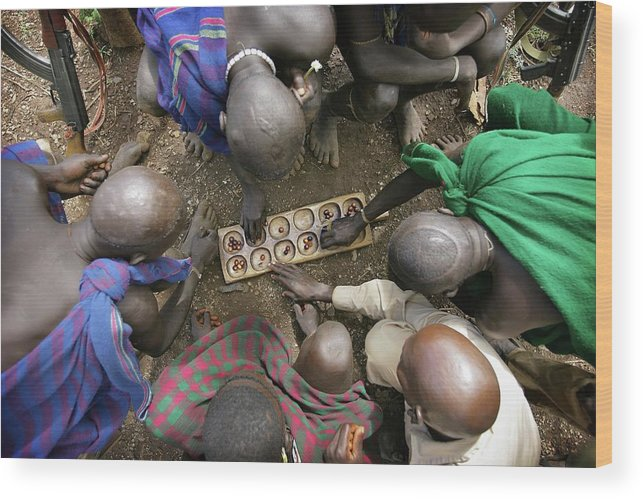 Nut Wood Print featuring the photograph Suri Tribal Game Of Mancala Seen From by Timothy Allen