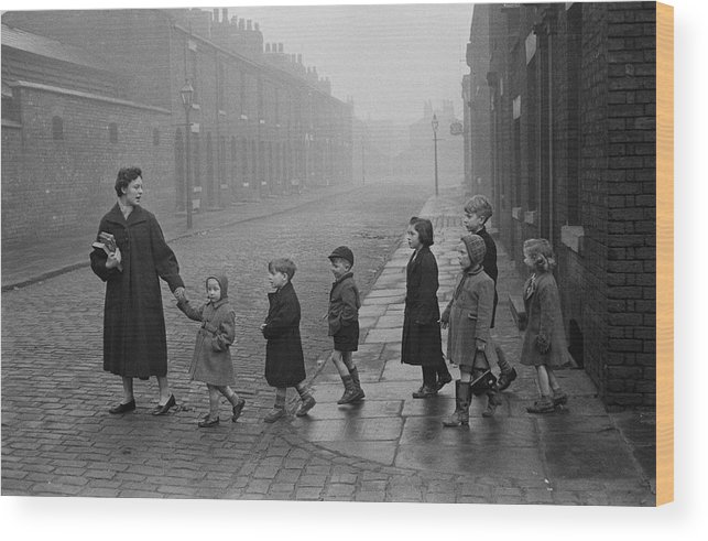 Following Wood Print featuring the photograph Teacher And Pupils In Manchester by Bert Hardy