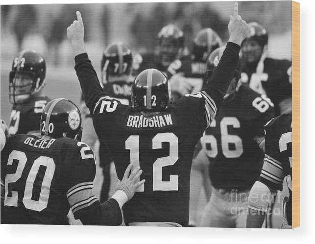 American Football Uniform Wood Print featuring the photograph Terry Bradshaw With Arms Raised by Bettmann