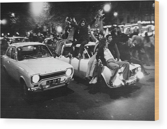The End Wood Print featuring the photograph The Carnation Revolution In Lisbon by Herve Gloaguen