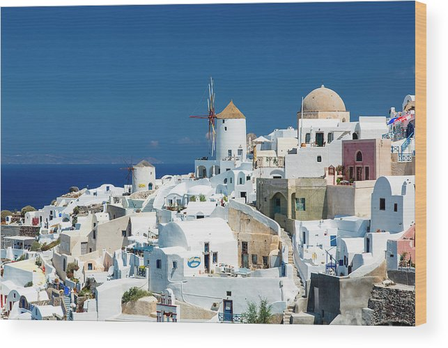 Greek Culture Wood Print featuring the photograph The Small Greek Village Of Oia by Sylvain Sonnet