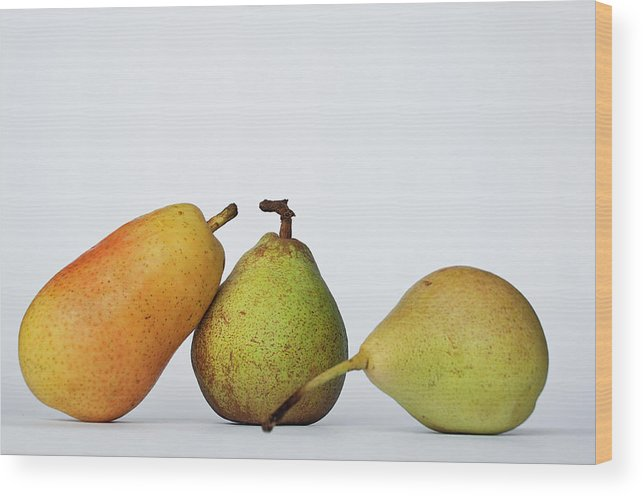 Healthy Eating Wood Print featuring the photograph Three Diferent Pears Isolated On Grey by Irantzu Arbaizagoitia Photography