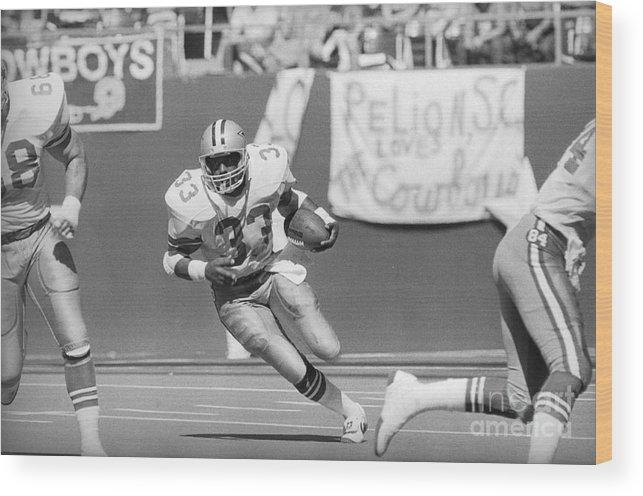 1980-1989 Wood Print featuring the photograph Tony Dorsett Running With Football by Bettmann
