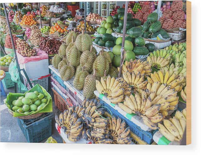 Mango Fruit Wood Print featuring the photograph Tropical Fruit At A Street Market In by Tbradford
