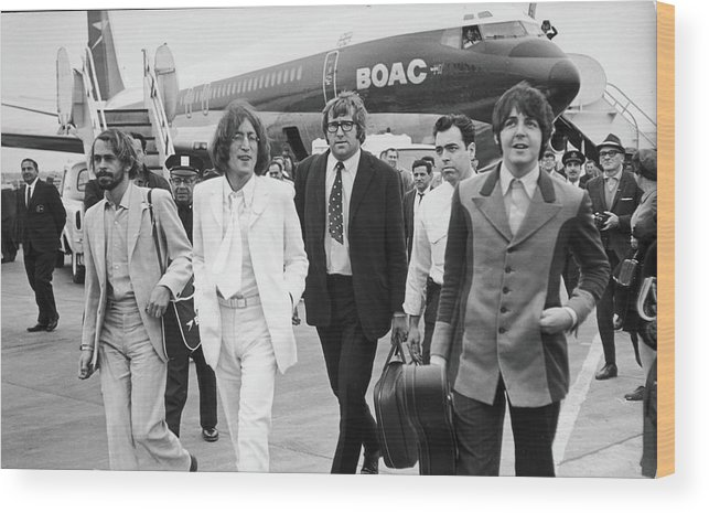 Following Wood Print featuring the photograph Two Beatles Arrive In New York by Fred W. McDarrah