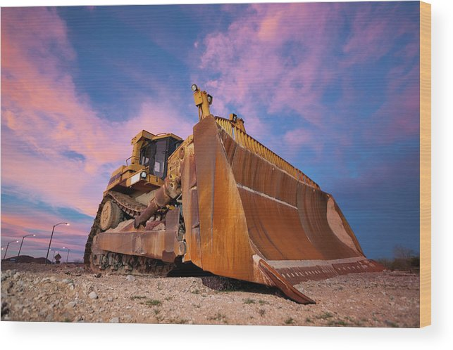 Toughness Wood Print featuring the photograph Yellow Bulldozer Working At Sunset by Wesvandinter