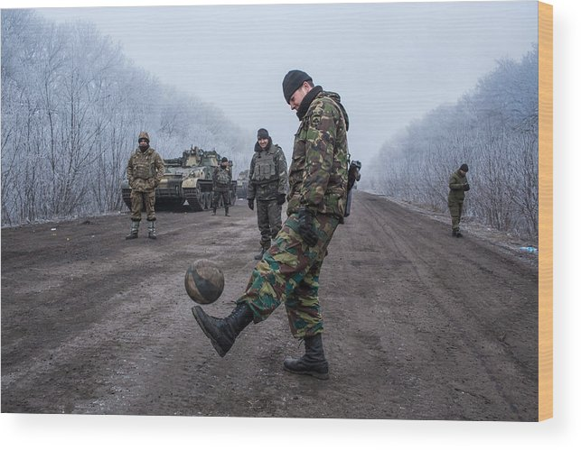 2014 Russian Military Intervention In Ukraine Wood Print featuring the photograph A Ceasefire Is Brokered In War Torn Eastern Ukraine by Brendan Hoffman