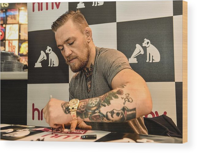 Dvd Wood Print featuring the photograph Conor McGregor DVD Signing by Sportsfile
