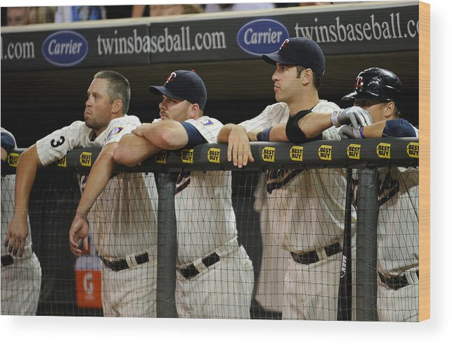 Joe Mauer Wood Print featuring the photograph Detroit Tigers v Minnesota Twins by Hannah Foslien