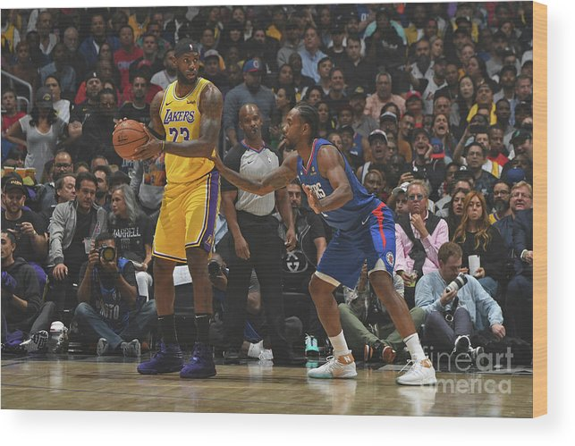 Nba Pro Basketball Wood Print featuring the photograph Kawhi Leonard and Lebron James by Andrew D. Bernstein