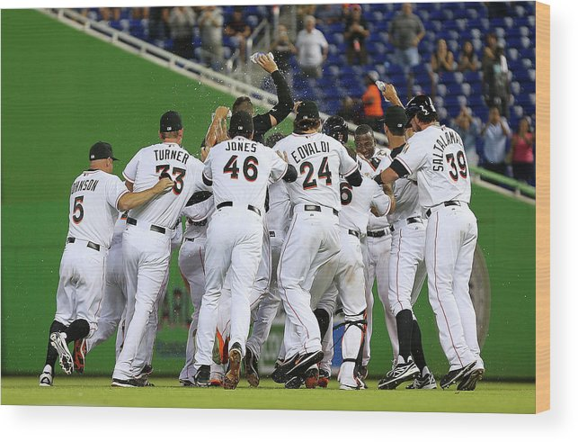 American League Baseball Wood Print featuring the photograph Marcell Ozuna by Mike Ehrmann