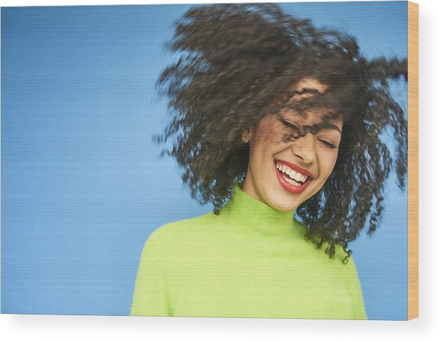 Cool Attitude Wood Print featuring the photograph Colourful studio portrait of a young woman dancing by Flashpop