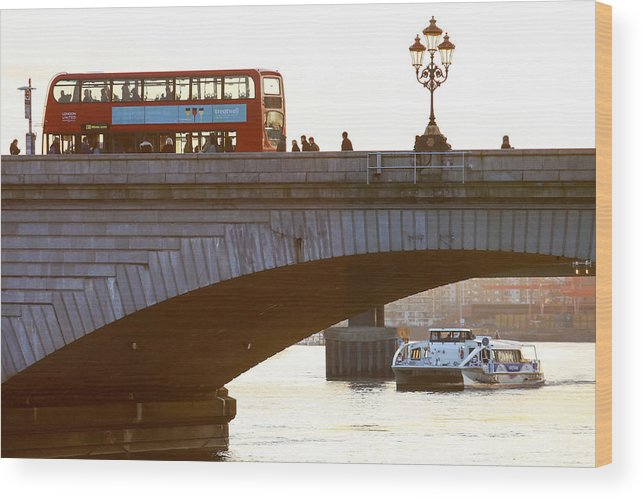 England Wood Print featuring the photograph Commuters Use New High-Speed Catamaran Clippers Operated By MBNA Thames Clippers by Bloomberg