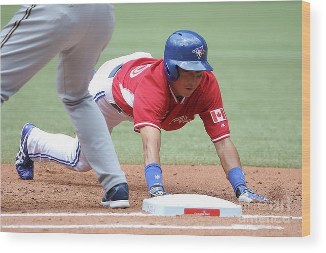American League Baseball Wood Print featuring the photograph Jay Rogers by Tom Szczerbowski