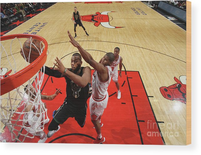 Nba Pro Basketball Wood Print featuring the photograph Greg Monroe by Gary Dineen
