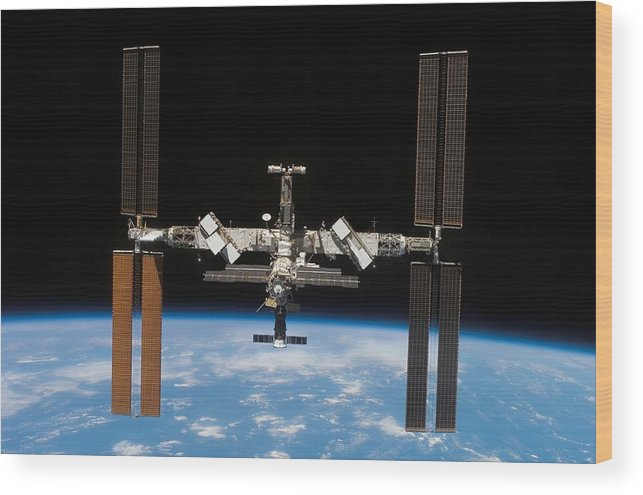 Curve Wood Print featuring the photograph International Space Station by Stocktrek Images