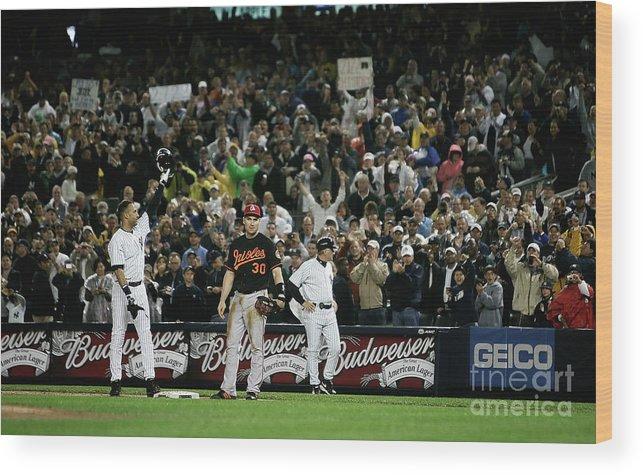 American League Baseball Wood Print featuring the photograph Derek Jeter by Mike Ehrmann
