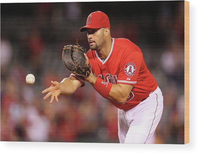 American League Baseball Wood Print featuring the photograph Albert Pujols, Nick Franklin, and Cam Bedrosian by Stephen Dunn