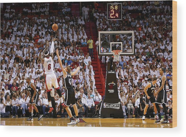 Playoffs Wood Print featuring the photograph Andrei Kirilenko and Lebron James by Mike Ehrmann