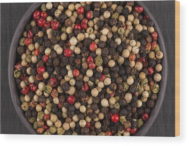 Black Color Wood Print featuring the photograph Bowl Of Various Pepper Peppercorns Seeds Mix On Dark Stone by R.Tsubin