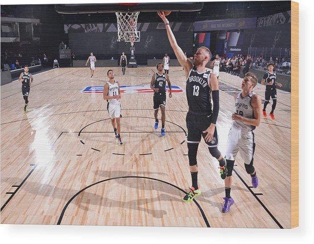 Nba Pro Basketball Wood Print featuring the photograph Brooklyn Nets v San Antonio Spurs by Jesse D. Garrabrant